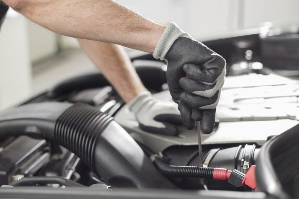 Automobile mechanic repairing car in automobile store